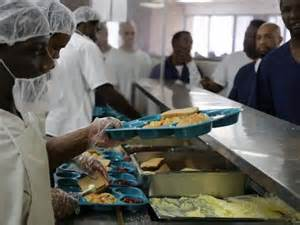 chow in prison. Sanitary hair nets around food