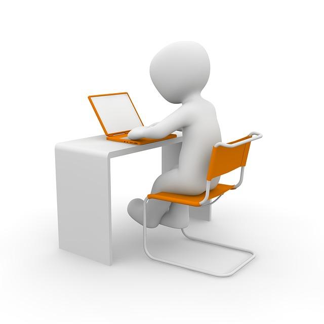 White man sitting at computer